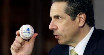 New York Gov. Andrew Cuomo, defying history, hasn't thrown a first pitch. Is this the year?