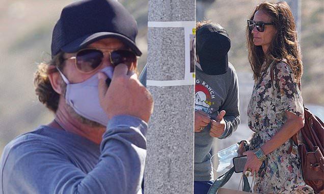 Gerard Butler enjoys an intimate chat with girlfriend Morgan Brownafter shopping in Malibu