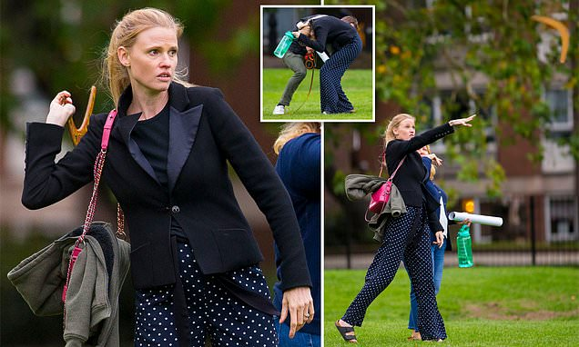 Dutch model Lara Stone, 36, and her new lover use a boomerang in the park